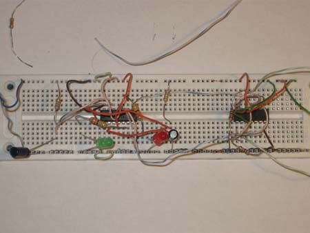Breadboard with two And gate chips and LEDs for direction indication