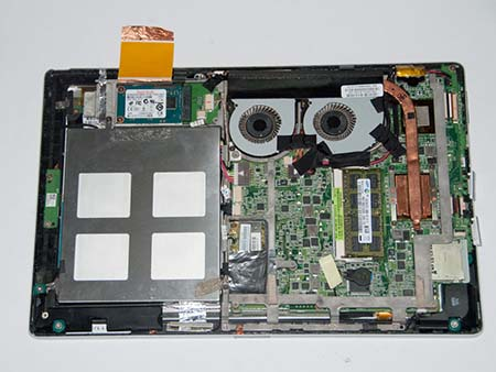 Remove the back cover starting at USB ports
