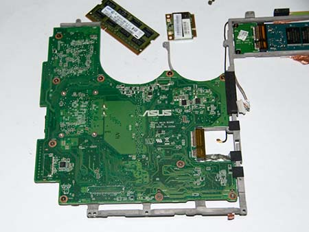 Remove the screws holding the motherboard to metal frame