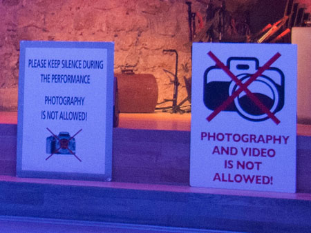 The no photography sign on the night