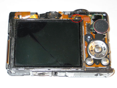 Remove the screw which holds the LCD screen in place