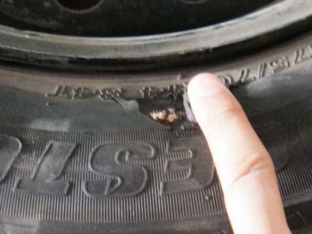 A puncture to the tyre's side wall