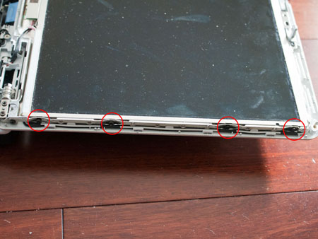 Remove four screws on each side of the LCD