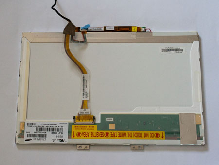 The removed LCD screen revealing the LCD cable