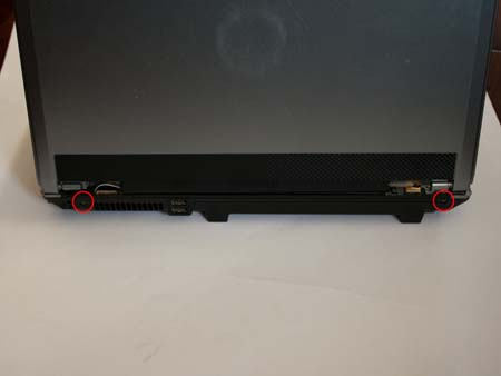 Remove the two screws from the back rear of the laptop