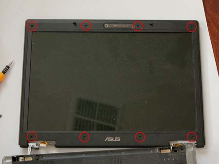 Remove the eight screw caps and screws around the LCD bezel